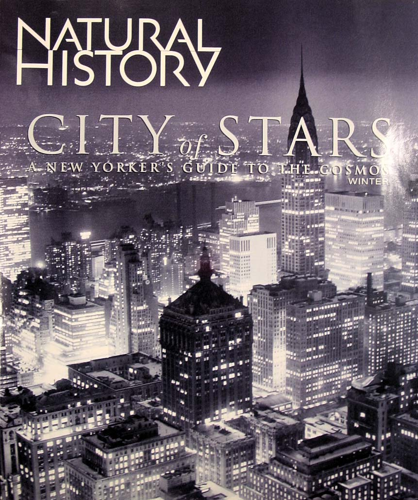 Cover of the Natural History magazine with the titles superimposed on a black and white photo of the city from a high locale looking down on the buildings.